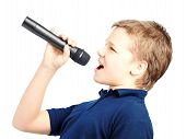 picture of singing  - Teenage boy singing into a microphone on a white background - JPG