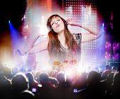 stock photo of singing  - beautiful woman listening to music and singing - JPG