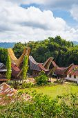 stock photo of life-boat  - Little traditional village with tipical boat shaped roofs in idyllic location among beautiful terraced rice paddies and jungle in the hilly region of Batutumonga Tana Toraja South Sulawesi Indonesia - JPG