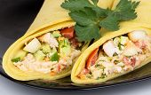 picture of shawarma  - Close up of Shawarma with chicken and parsley on black plate - JPG