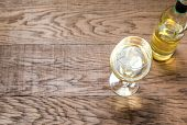 picture of shiraz  - Glass And Bottle With White Wine On The Wooden Background - JPG