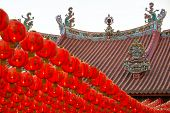 stock photo of yin  - Chinese New Year red and yellow paper lanterns in Kuan Yin Temple - JPG
