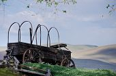 picture of wagon  - Covered Wagon At The Edge Of The Desert - JPG