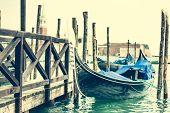 stock photo of gondola  - gondola at berth on the Venice channel - JPG