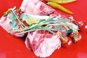 picture of red meat  - fresh raw beef red meat fillet medallion chunks on red plate isolated over white background - JPG