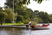 pic of sloop  - a sloop with flag in a dutch landscape - JPG