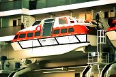 foto of life-boat  - Life boat attached to a cruise ship with a smooth watercolor filter - JPG