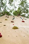 picture of climbing wall  - view from the ground looking up at an outdoor climbing wall - JPG