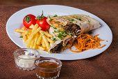stock photo of shawarma  - Dish in white plate with Shawarma  - JPG
