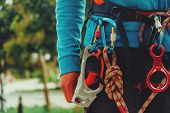 stock photo of climb up  - Rock climber wearing safety harness and climbing equipment outdoor close - JPG