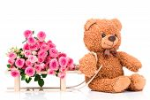 picture of bunch roses  - Bunch of roses and a teddy bear on white background - JPG