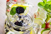 foto of infusion  - Fresh infused water made with organic ccitruses and berries - JPG