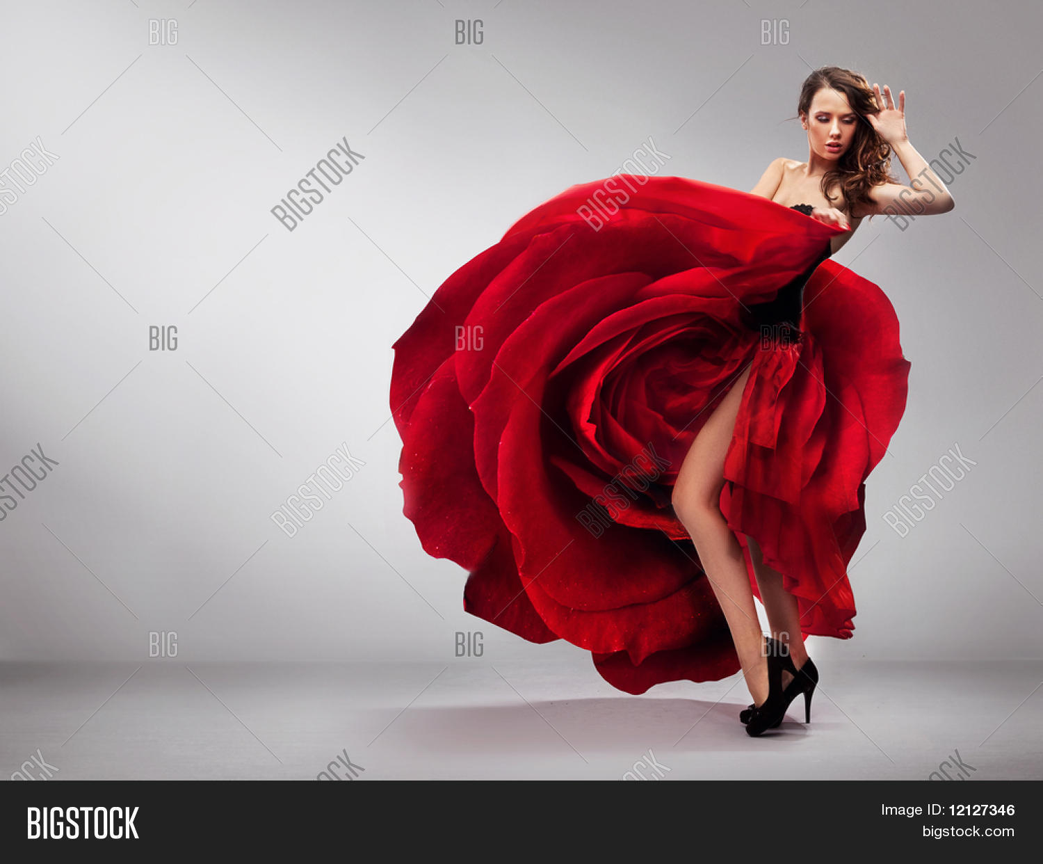 Beautiful young lady wearing red rose dress Stock Photo & Stock ...