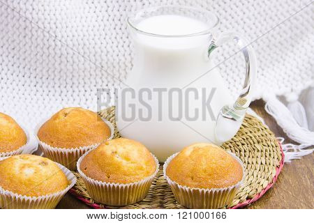 Sweet Vanilla Domestic Cakes And Carafe With Milk
