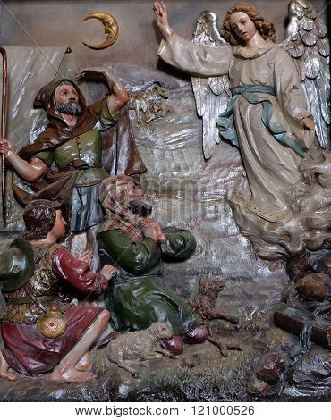 STITAR, CROATIA - AUGUST 27: Angel of the Lord visited the shepherds and informed them of Jesus' birth, altarpiece in the church of Saint Matthew in Stitar, Croatia on August 27, 2015