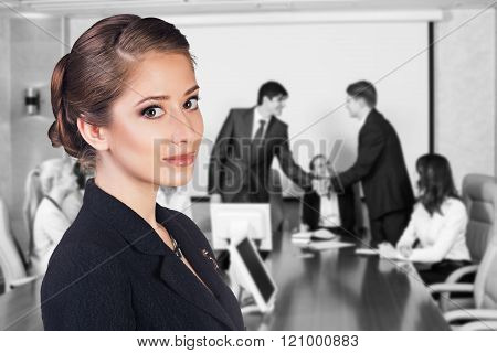 People shaking hands, finishing up a meeting