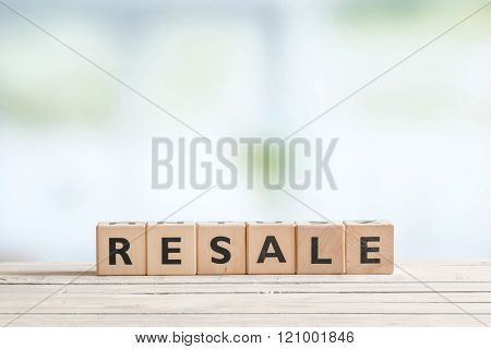 Resale Sign On A Wooden Desk