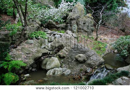 Small creek in the chinese garden in spring time