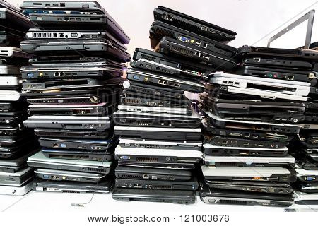 Stack Of Old, Broken And Obsolete Laptop Computer
