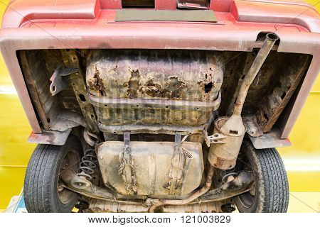 Car With Rusty, Damaged, Corroded Undercarriage At Workshop For Repair