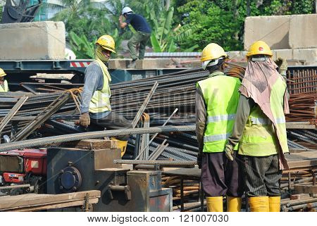 SEPANG, MALAYSIA - APRIL 08, 2015: Bar bending yard at the construction site. Construction workers bend the reinforcement bar follows the design.