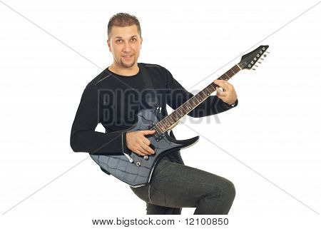 Mid Adult Man Playing Guitar