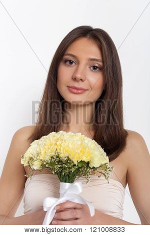 Young Cute Woman Holding Bunch Of Flowers