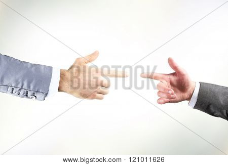 Two hands with fingers tip to tip symbolizing contact
