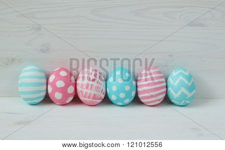 Pink And Blue Easter Eggs On A Wooden Background
