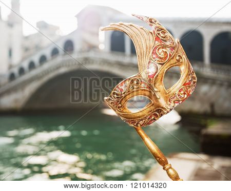 Closeup On Woman Hand Holding Venice Mask Near Rialto Bridge