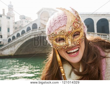 Happy Woman Holding Venice Mask In The Front Of Rialto Bridge