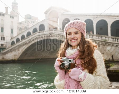 Woman Tourist With Retro Camera In The Front Of Rialto Bridge