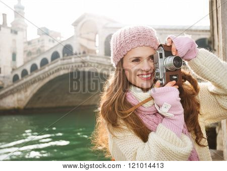 Woman Tourist Taking Photos With Retro Photo Camera In Venice
