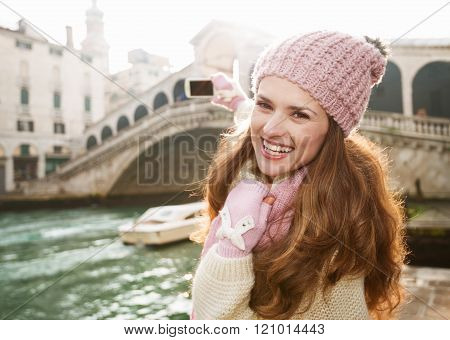 Woman Tourist Taking Photo With Smartphone Of Rialto Bridge