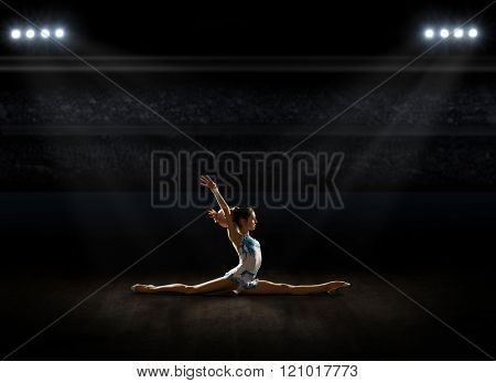 Girl engaged art gymnastic at sports hall
