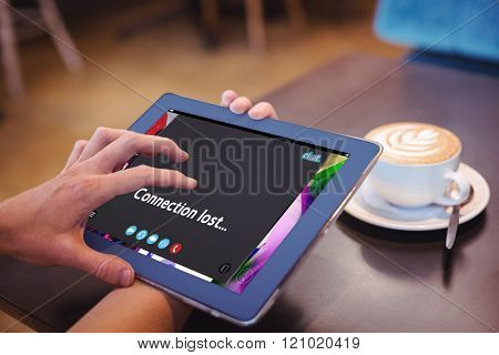 Music app against close-up of digital tablet and coffee on table Close-up of digital tablet and coffee on table in the coffee shop