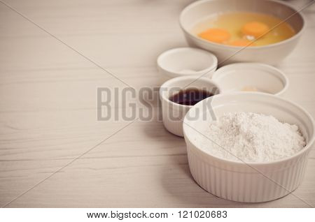 Ingredients for baking cake, flour and egg