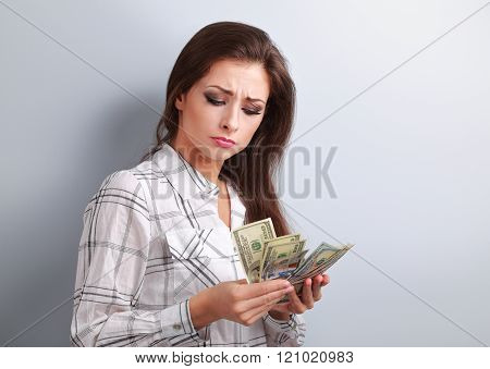 Beautiful Young Unhappy Woman Looking On Dollars And Thinking How Little Money She Have Earned