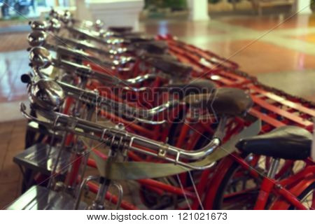 red retro bicycle with handbell on street abstract blur image background