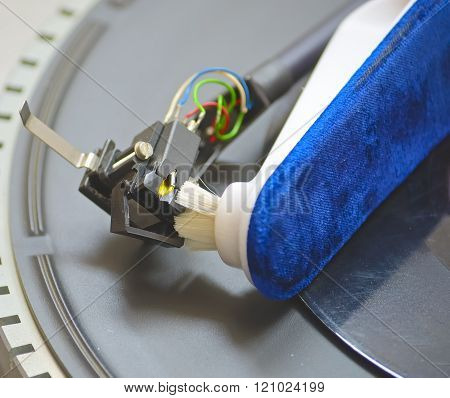 Close-up of a cleaning cartridge stylus turntable with brush
