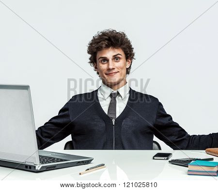 Friendly young manager is glad to see the client welcomed with open arms.