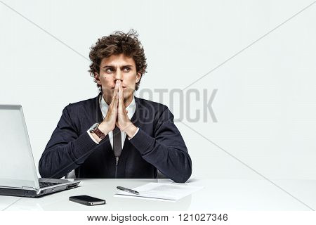Businessman with intense expression looking up into the corner.