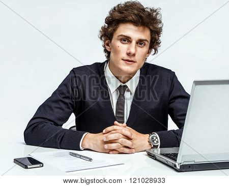 Ambitious young businessman looking at camera with serious look