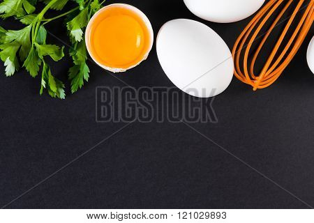 Broken eggs with a whisk. Free space for text