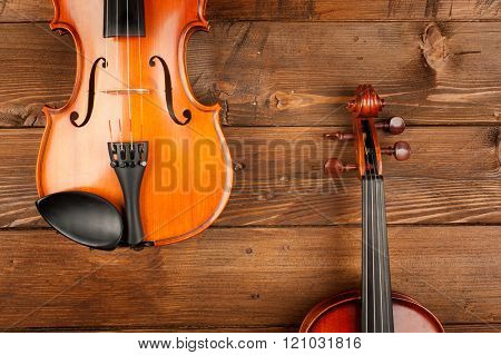 two violins in wood background