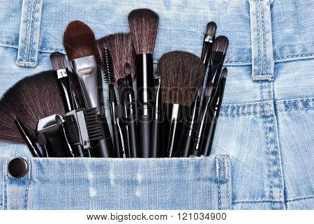 Applicators And Makeup Brushes In Jeans Pocket