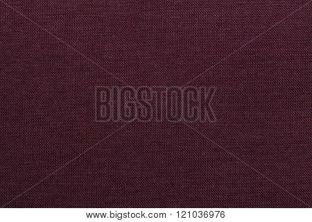 Burgundy red textile texture. Burgundy red background.