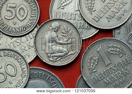 Coins of Germany. Woman planting an oak seedling depicted in the German 50 pfennig coin.