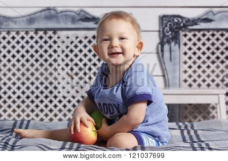 Baby boy in parent's bed with paraffin wax apples
