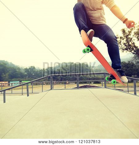 young skateboarder skateboarding at skatepark